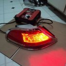 03 BMW 750 LI DRIVER LEFT LED TAIL LIGHT  WITH CROME MOULDING.