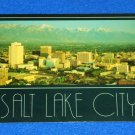 VINTAGE MARVELOUS SALT LAKE CITY SKYLINE POSTCARD MEMENTO WASATCH MOUNTAIN RANGE