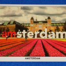 BRAND NEW STRIKING GREETINGS FROM AMSTERDAM POSTCARD DUTCH NATIONAL RIJKSMUSEUM