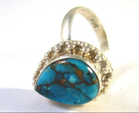 Old silver ring with turquoise