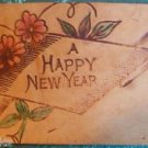 A Happy New Year Scroll & Flowers - Antique LEATHER POSTCARD Unused