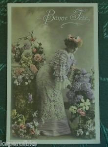 FRENCH LADY PICKS FLOWER-Hand Color-ANTIQUE VINTAGE ORIGIN RPPC PHOTO POSTCARD