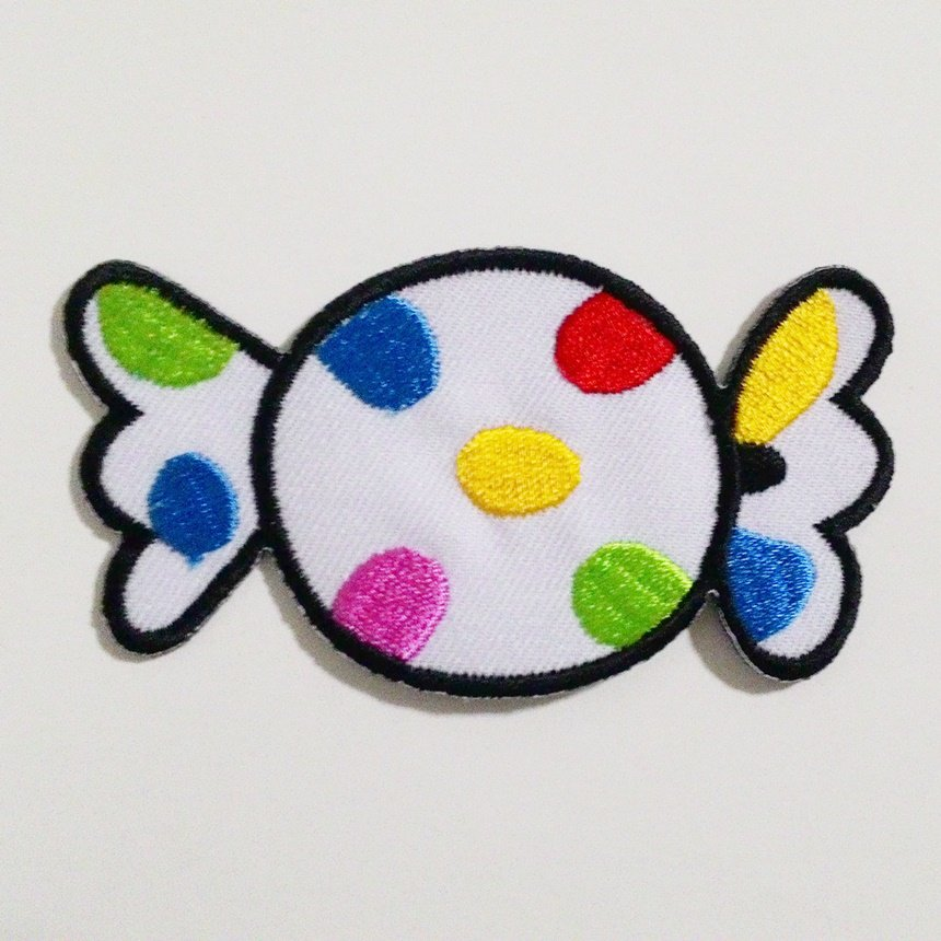 White candy embroidered iron on patch.