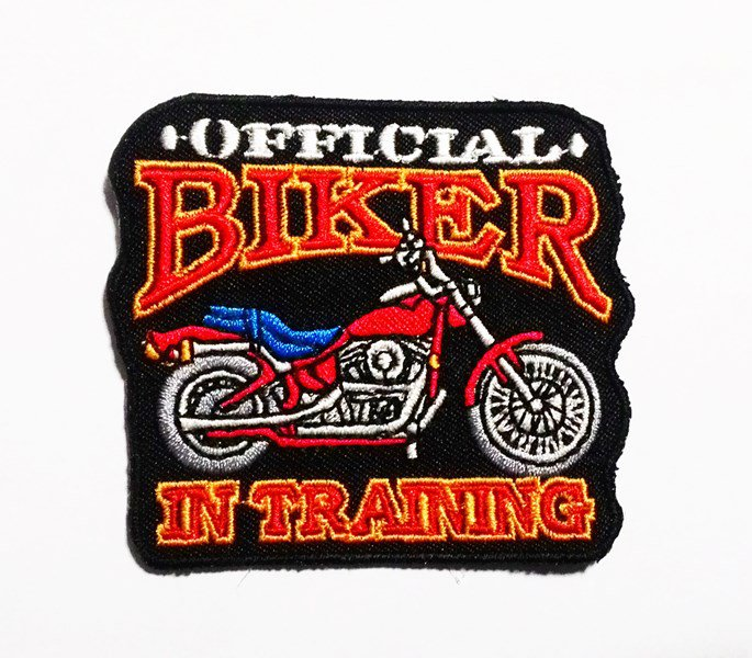 The official biker in training iron on patch.