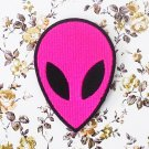 The pink alien iron-on patch.