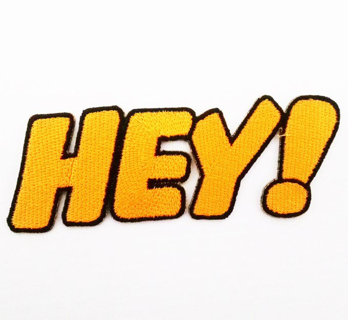 Hey! text embroidered iron on patch.