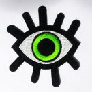 Embroidered Demon green eye iron-on patch.