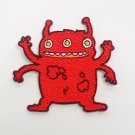 Red monster's four arms and three eyes Iron On Patch.