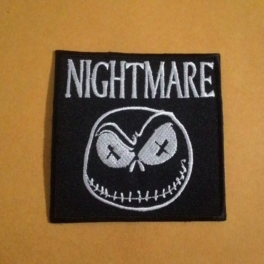 Nightmare embroidered iron on patch.