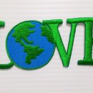 Embroidered green love earth iron-on patch.