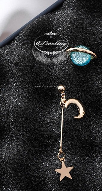 Saturn earrings and stars moon section asymmetric cosmic elements blue.