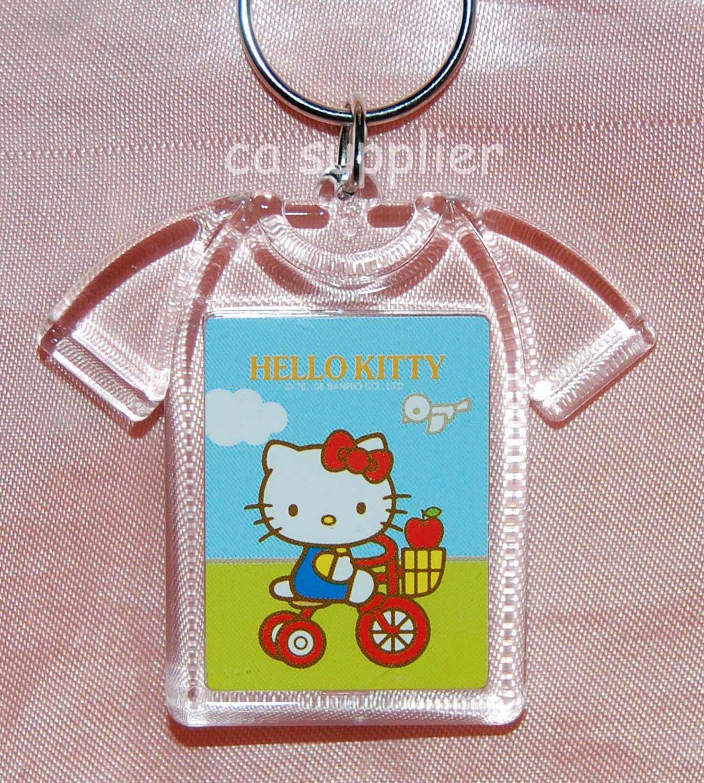 """2005 Sanrio T Shirt Shape Hello Kitty Key Ring 2.5""""W x 2""""L - Cycling"""