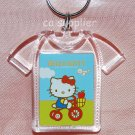"2005 Sanrio T Shirt Shape Hello Kitty Key Ring 2.5""W x 2""L - Cycling"