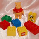 USED Winnie The Pooh Figure & 7 pieces Lego Building Blocks