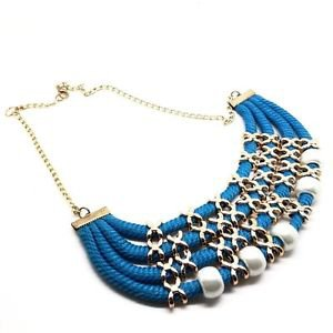 WOMEN'S BLUE NECKLACE DECORATED WITH PEARLS AND CORDONS