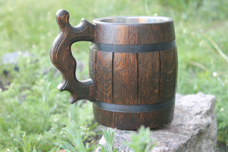 Dark wooden beer mug with metal cup inside