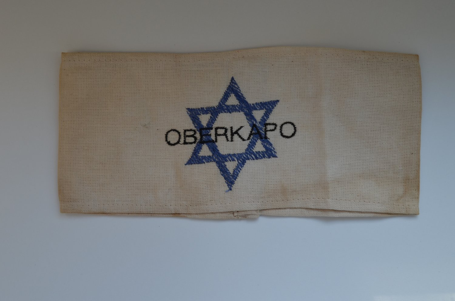 WWII THE JEWISH ARMBAND WITH THE CONCENTRATION CAMP OBERKAPO