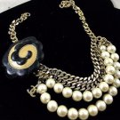 VINTAGE CHANEL CAMELLIA ACCESSORIES CLIP. FAUX PEARLS & LEATHER *NOT NECKLACE*