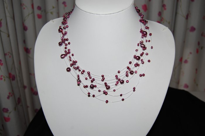 Celestial 10 strand pearl Cranberry N1150