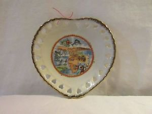Collectible Florida commemorative heart shaped Plate with gold trim.