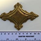 Original antique pressed brass furniture mount mirror cartouche emblem G10