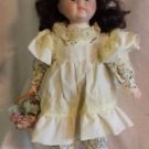 "16"" PORCELAIN DOLL IN CREAM DRESS WITH FLORAL TRIM AND FLOWER BASKET"
