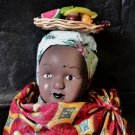Small vintage porcelain doll / Ethnic