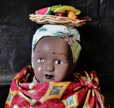 Small vintage porcelain doll / Ethnic