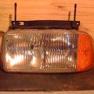 GM16516935U USED Left Headlamp Assembly 1994-1997 Sonoma/Jimmy 1995-1997 Bravada