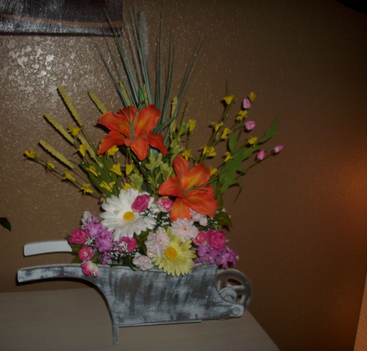 Floral-Bouquet-Center-Piece-Tropical-in-a-wheel-barrel-made-of-Wood