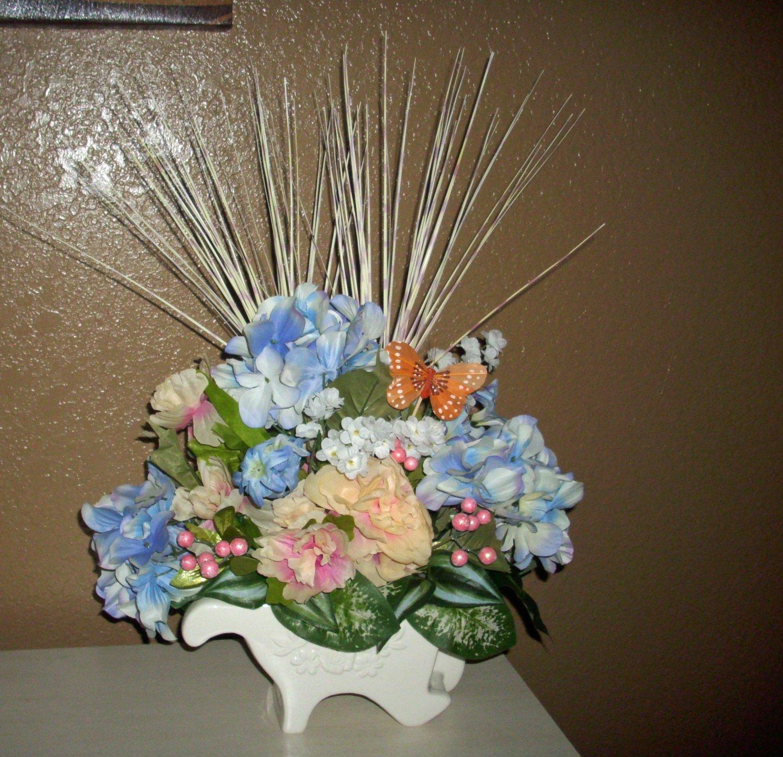 Pastel-Floral-Arrangement-Centerpiece-Glass-wheel-barrel