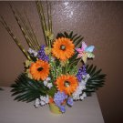 Silk Spring Floral Arrangement, in orange, yellows and lots of greens