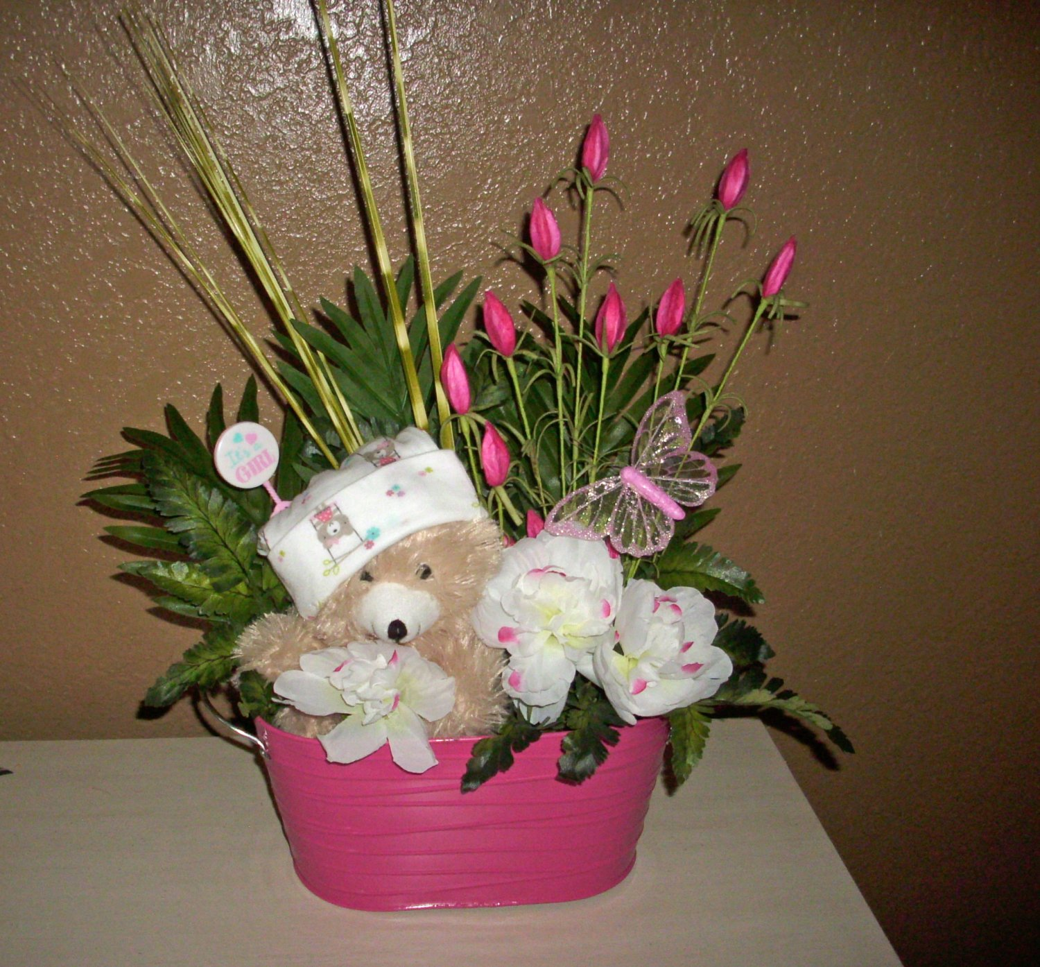 Baby Shower Silk Floral Arrangement, in pink, white and lots of greens, toys