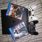 Playstation 4 games and controllers included