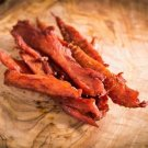 Handcut Thick smoked chicken jerky marinated in mild buffalo 8 ounce portion