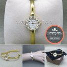 Gold Women Quartz Analog Wrist Watch Brass Bangle White Enamel Bezel Steel Back