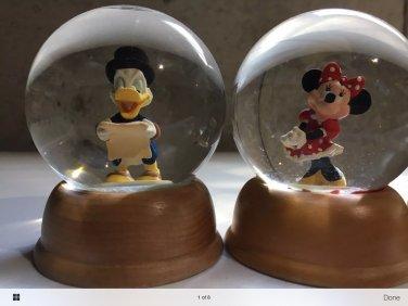 Minnie and Doanld snow globes