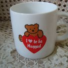 I LOVE TO BE HUGGED TEDDY BEAR CERAMIC MUG ***NEW***