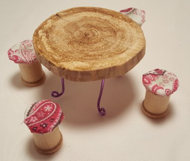 Tiny driftwood table with spool chairs