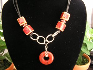 Black cord with clay and silver plated beads and findings beautiful red jasper doughnut pendant