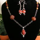 Sterling silver with  obsidian and agate beads adorned with carnelian pendant
