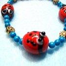 Lady Bug Bracelet, Turquoise Blue Howlite Stone, Large Size Beaded Golden Daisy Bracelet