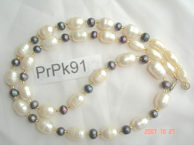Genuine fresh water pearl necklace with rich luster color of peacock, peach, or mauve.