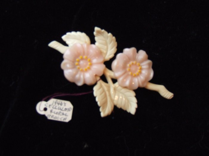 Pin  Celluloid floral brooch