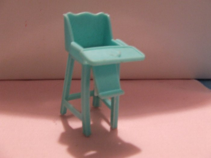 Dollhouse Furniture Molded turquoise plastic highchair  marked Superior