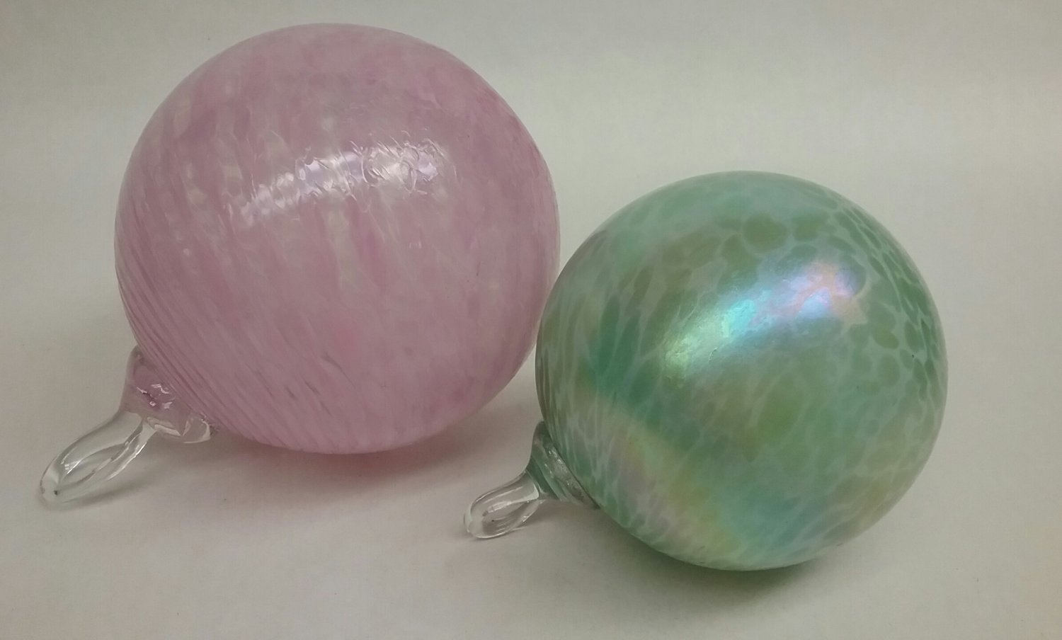 Two art glass ball ornaments