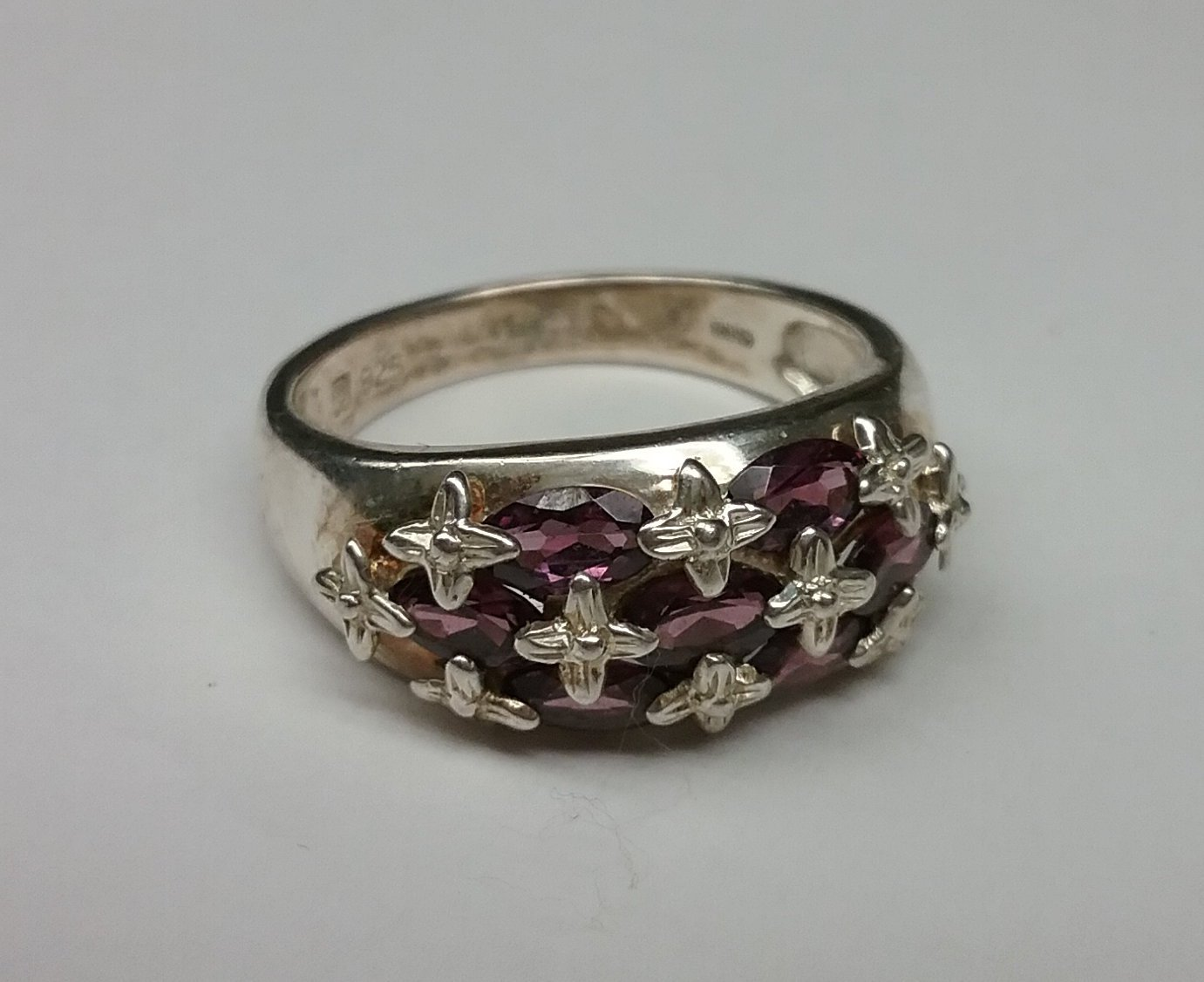 Sterling silver ring with oval amethyst color stones. Large size
