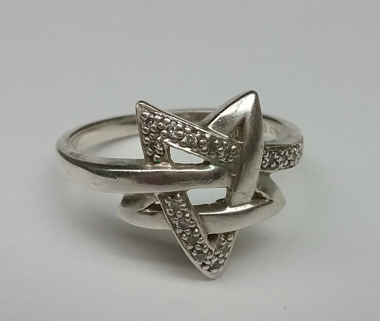Sterling silver ring, star shape with diamonds.  Large size