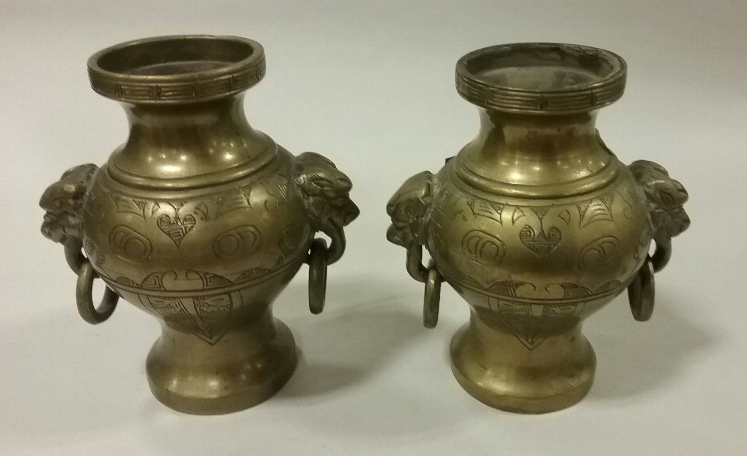 Pair of Chinese brass vases with lion face ring handles