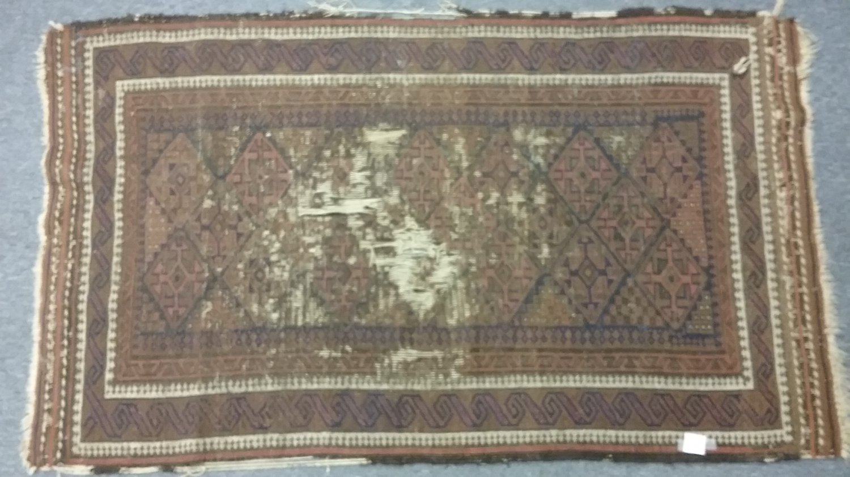 Distressed hand made rug.  Wool